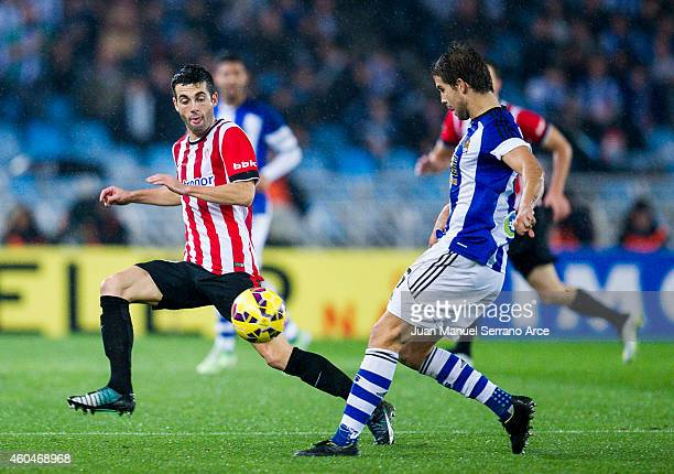 Markel Susaeta of Athletic Club duels for the ball with Inigo Martinez of Real Sociedad during the La Liga match between Real Sociedad and Athletic...
