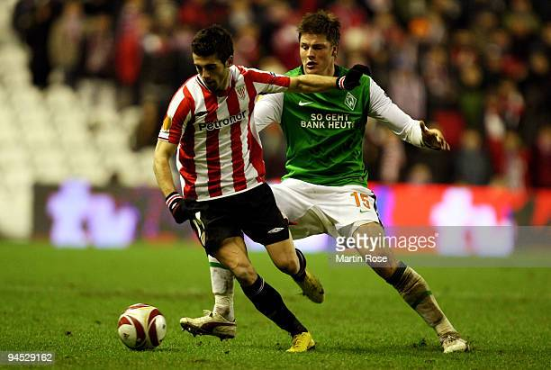 Markel Susaeta of Bilbao and Sebastian Proedl of Bremen compete for the ball during the UEFA Europa League Group L match between Atletico Bilbao and...