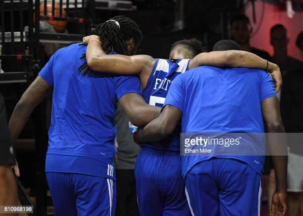 Markelle Fultz of the Philadelphia 76ers is helped off the court by teammates after he appeared to injure his left ankle during a 2017 Summer League...