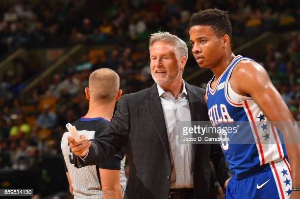 Markelle Fultz and Head Coach Brett Brown of the Philadelphia 76ers talk during a preseason game against the Boston Celtics on October 9 2017 at TD...