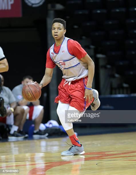 Markelle Fultz in white brings the ball up the court during the NBPA Top 100 Camp on June 18 2015 at John Paul Jones Arena in Charlottesville Virginia