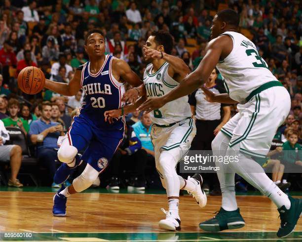 Markelle Fultz of the Philadelphia 76ers dribbles down the court during the game against the Boston Celtics at TD Garden on October 9 2017 in Boston...