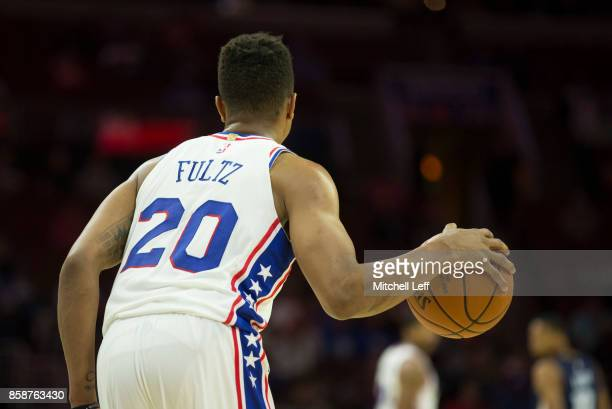 Markelle Fultz of the Philadelphia 76ers dribbles the ball against the Memphis Grizzlies during the preseason game at the Wells Fargo Center on...