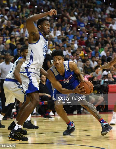 Markelle Fultz of the Philadelphia 76ers drives against Damian Jones of the Golden State Warriors during the 2017 Summer League at the Thomas Mack...
