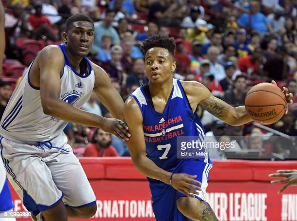 Markelle Fultz of the Philadelphia 76ers drives against Kevon Looney of the Golden State Warriors during the 2017 Summer League at the Thomas Mack...