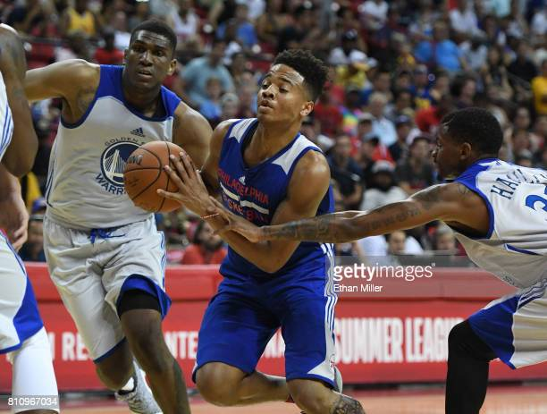 Markelle Fultz of the Philadelphia 76ers drives against Kevon Looney and Alex Hamilton of the Golden State Warriors during the 2017 Summer League at...