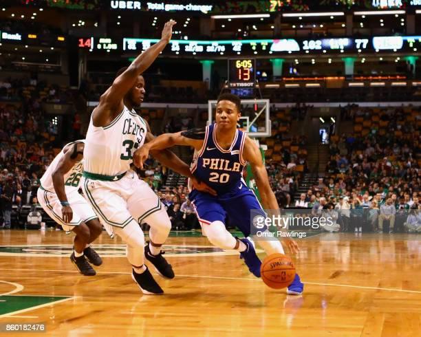 Markelle Fultz of the Philadelphia 76ers drives on Semi Ojeleye of the Boston Celtics during the game at TD Garden on October 9 2017 in Boston...