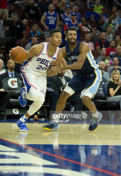 Markelle Fultz of the Philadelphia 76ers drives to the basket against Andrew Harrison of the Memphis Grizzlies during the preseason game at the Wells...