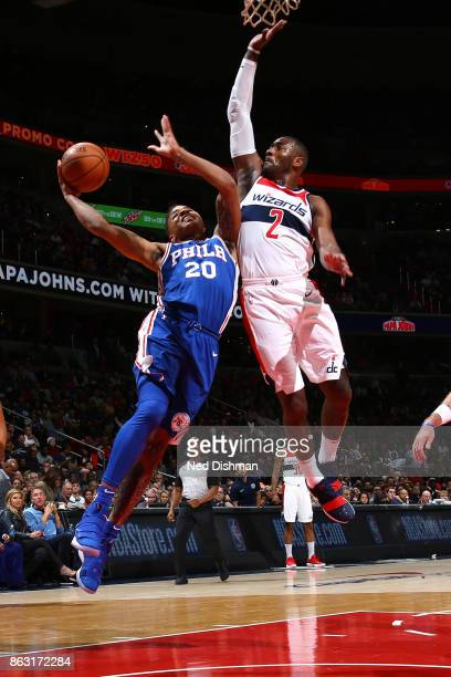 Markelle Fultz of the Philadelphia 76ers drives to the basket against John Wall of the Washington Wizards on October 18 2017 at Capital One Arena in...