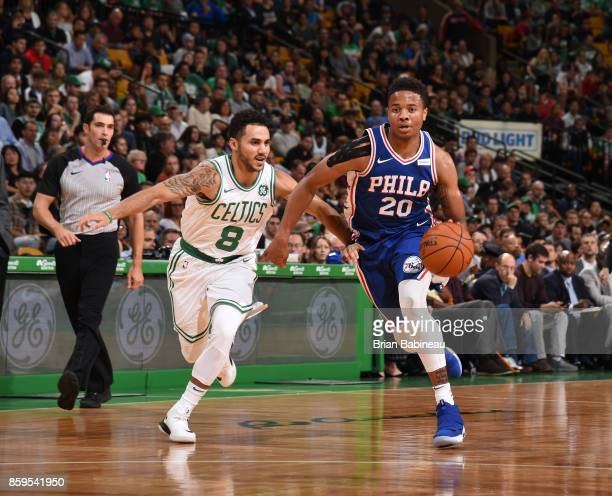 Markelle Fultz of the Philadelphia 76ers handles the ball against Shane Larkin of the Boston Celtics during the preseason game on October 9 2017 at...