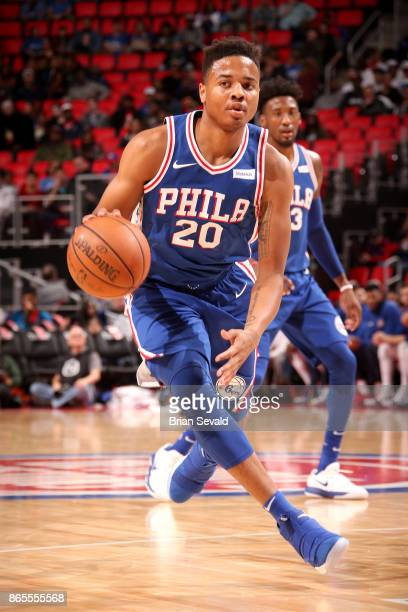 Markelle Fultz of the Philadelphia 76ers handles the ball against the Detroit Pistons on October 23 2017 at Little Caesars Arena in Detroit Michigan...