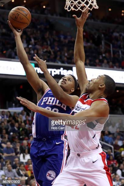 Markelle Fultz of the Philadelphia 76ers puts up a shot in front Otto Porter Jr #22 of the Washington Wizards in the first half at Capital One Arena...