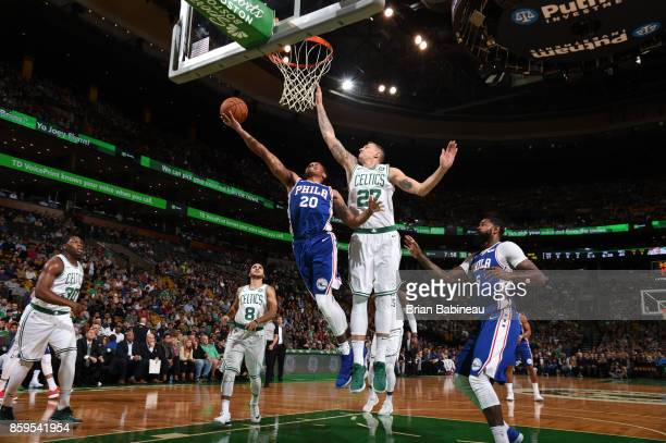 Markelle Fultz of the Philadelphia 76ers shoots a lay up against Daniel Theis of the Boston Celtics during the preseason game on October 9 2017 at...