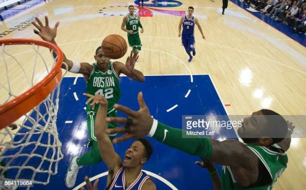 Markelle Fultz of the Philadelphia 76ers shoots the ball against Al Horford and Kyrie Irving of the Boston Celtics in the third quarter at the Wells...