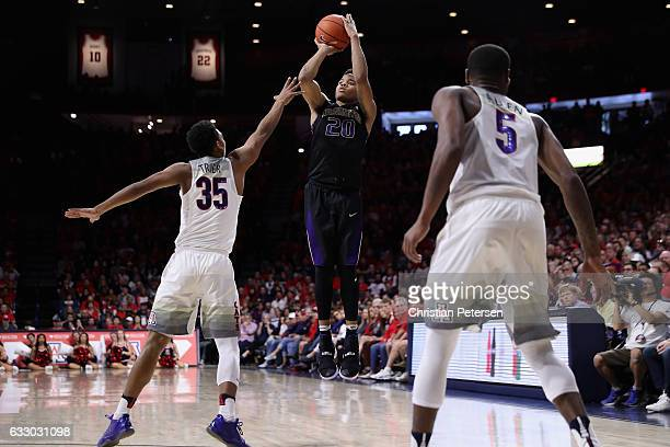 Markelle Fultz of the Washington Huskies attempts a shot over Allonzo Trier of the Arizona Wildcats during the second half of the college basketball...