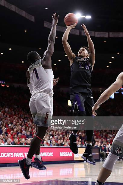 Markelle Fultz of the Washington Huskies attempts a shot over Rawle Alkins of the Arizona Wildcats during the second half of the college basketball...
