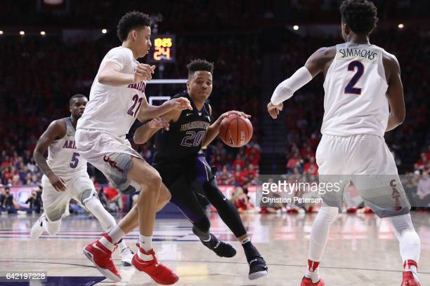 Markelle Fultz of the Washington Huskies drives the ball against Chance Comanche of the Arizona Wildcats during the second half of the college...
