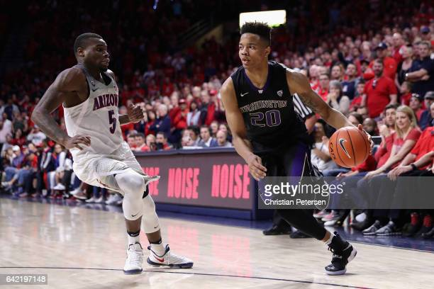 Markelle Fultz of the Washington Huskies handles the ball against Kadeem Allen of the Arizona Wildcats during the second half of the college...