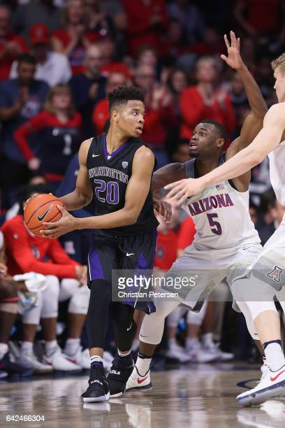Markelle Fultz of the Washington Huskies looks to pass around Kadeem Allen of the Arizona Wildcats during the first half of the college basketball...