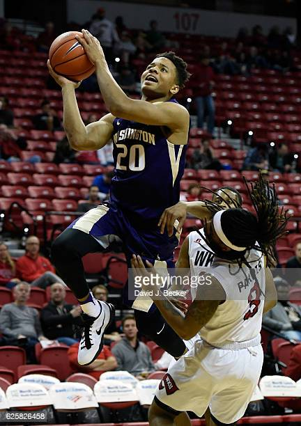 Markelle Fultz of the Washington Huskies shoots against Damari Parris of the Western Kentucky Hilltoppers during the Global Sports Classic basketball...