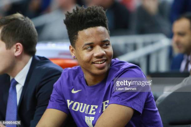 Markelle Fultz of the Washington Huskies sits on the bench with an injured ankle against the USC Trojans during a firstround game of the Pac12...