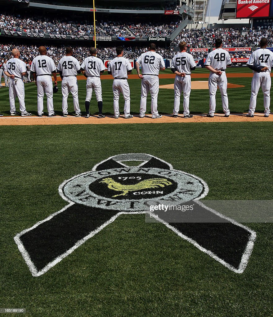 A marker for Newtown, Connecticut sits on a the filed during a moment of silence before the game between the New York Yankees and the Boston Red Sox during Opening Day on April 1, 2013 at Yankee Stadium in the Bronx borough of New York City.