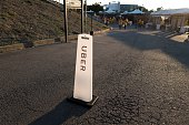 A marker indicates the pickup location for popular ride sharing service Uber following a Golden State Warriors basketball game at Oracle Arena...