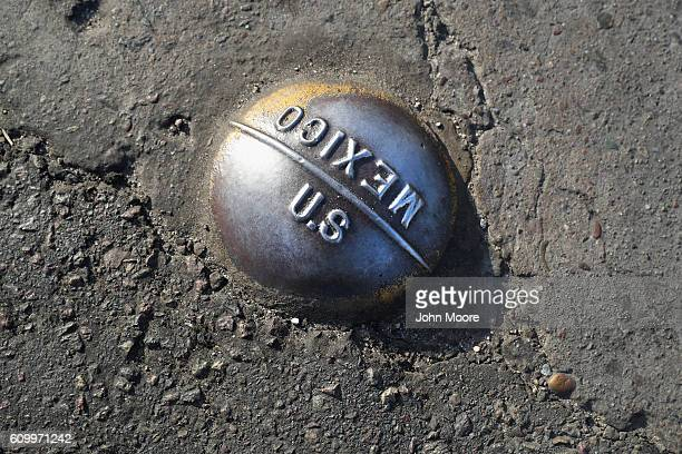 A marker lies on the USMexico border on September 23 2016 in San Ysidro California Daily more than 10000 people legally cross the border mostly for...
