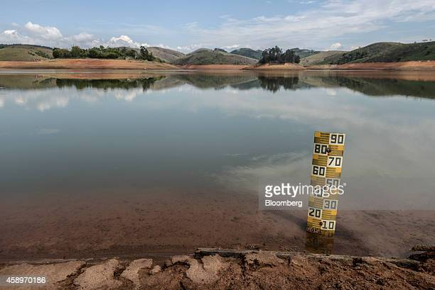 A marker measures the water level at the Jaguari Reservoir near Sao Jose dos Campos in the state of Sao Paulo Brazil on Thursday Nov 13 2014 The...