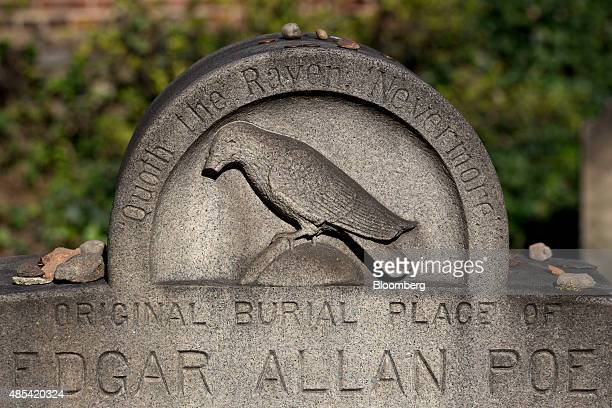 A marker stands at the original burial place of author Edgar Allen Poe in the Westminster Hall burying ground in Baltimore Maryland US on Wednesday...