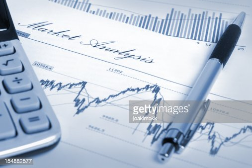 Market Analysis With Financial And Stock Market Chart Stock Photo