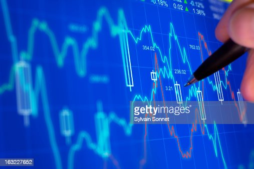 Market analyzing on a computer screen : Stock Photo