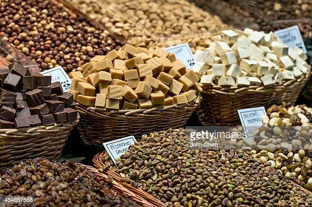 EL RAVAL BARCELONA CATALONIA SPAIN Market display of nuts and candy La Boqueria market