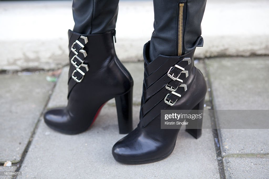 Market Editor for ELLE Magazine Bonnie Rakhit wears Christian Louboutin ankle boots on day 3 of London Womens Fashion Week Autumn/Winter 2013 on February 17, 2013 in London, England.