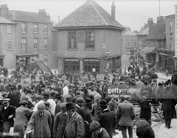 Market Place Faringdon Oxfordshire c1860c1922 A large crowd of prospective buyers looking at livestock during one of the town's sheep fairs The...