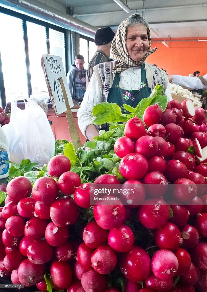 A market seller at her stall of radishes on April 16, 2013 in Timisoara, Romania. Romania has abandoned a target deadline of 2015 to switch to the single European currency and will now submit to the European Commission a programme on progress towards the adoption of the Euro, which for the first time will not have a target date.