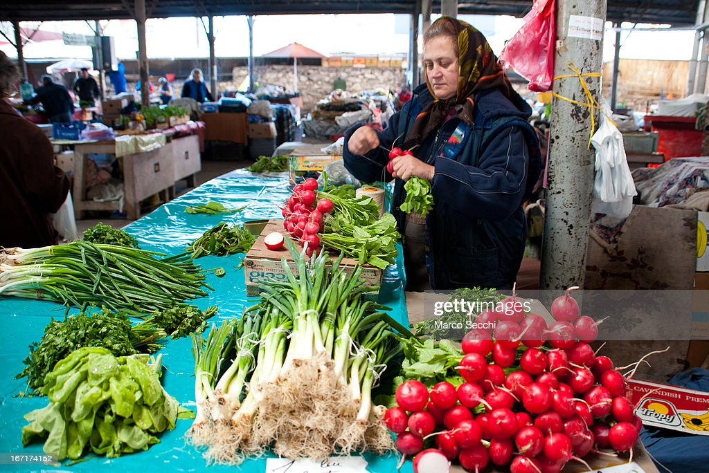 A market seller at her stall of vegetables in one of the daily markets on April 14, 2013 in Timisoara, Romania. Romania has abandoned a target deadline of 2015 to switch to the single European currency and will now submit to the European Commission a programme on progress towards the adoption of the Euro, which for the first time will not have a target date.