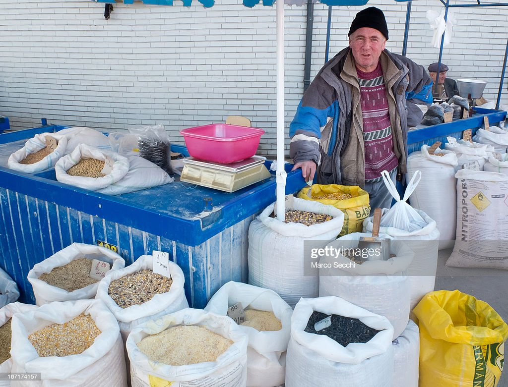 A market seller of bird food poses in front of his stall at the daily market on April 15, 2013 in Timisoara, Romania. Romania has abandoned a target deadline of 2015 to switch to the single European currency and will now submit to the European Commission a programme on progress towards the adoption of the Euro, which for the first time will not have a target date.