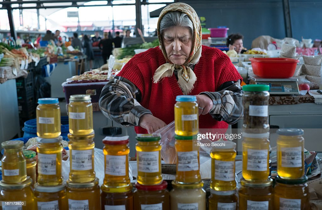 A market seller seen at her stall of honey at the daily market on April 16, 2013 in Timisoara, Romania. Romania has abandoned a target deadline of 2015 to switch to the single European currency and will now submit to the European Commission a programme on progress towards the adoption of the Euro, which for the first time will not have a target date.