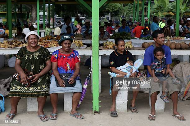 Market sellers wait to see Australian Prime Minister Julia Gillard during her tour of the Gerehu Market on May 10 2013 in Port Moresby Papua New...