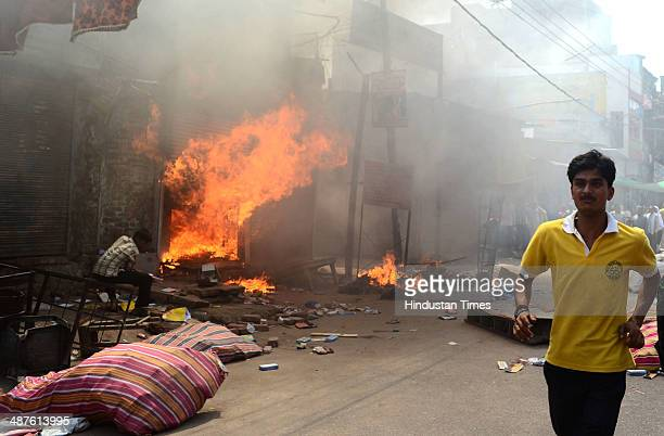 Market set on fire after a clash between two groups over possession of a piece of land in Chowk on May 1 2014 in Allahabad India Around a dozen...