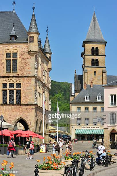 Market square with Denzelt medieval palace of justice and the basilica of Saint Willibrord at Echternach Luxembourg