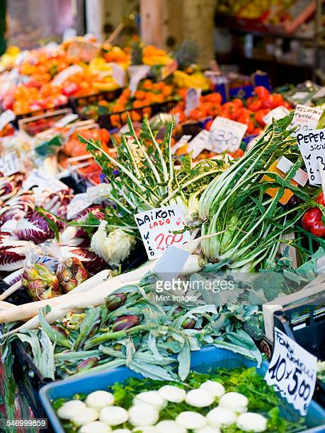 A market stall laden with fresh vegetables at the Rialto Food market.