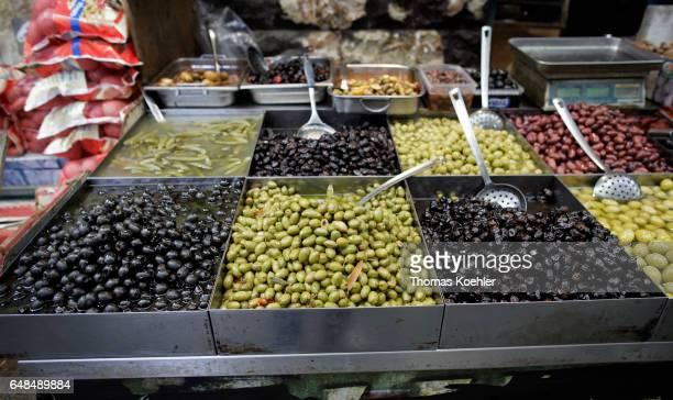 Market stall with olives on the Mahane Yehuda market in Jerusalem on February 08 2017 in Jerusalem Israel
