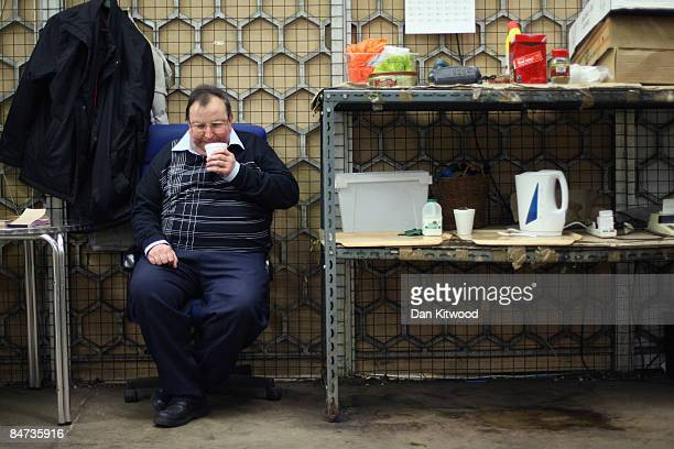 A market vendor takes a break from his stall in New Covent Garden Flower Market on February 11 2009 in London England New Covent Garden Flower Market...