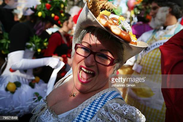 Market women in disguise arrive for the traditional Shrove Tuesday 'Market Women's Dance' at the Viktualien Market on February 5 2008 in Munich...