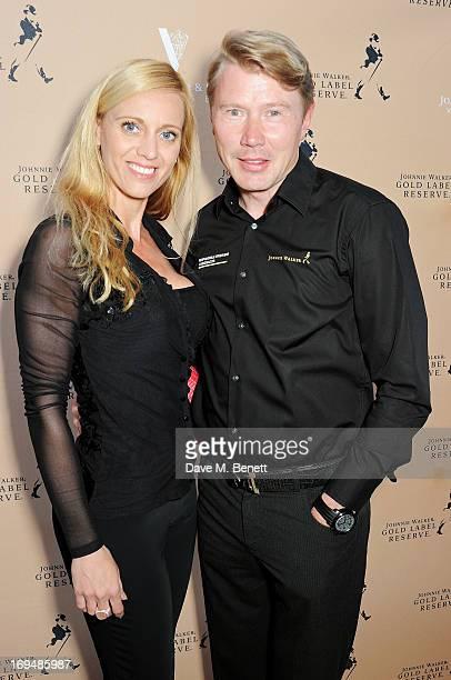 Marketa Kromatova and Twotime Formula One World Champion Mika Hakkinen attend the Johnnie Walker Gold Label Reserve cocktail party aboard the John...