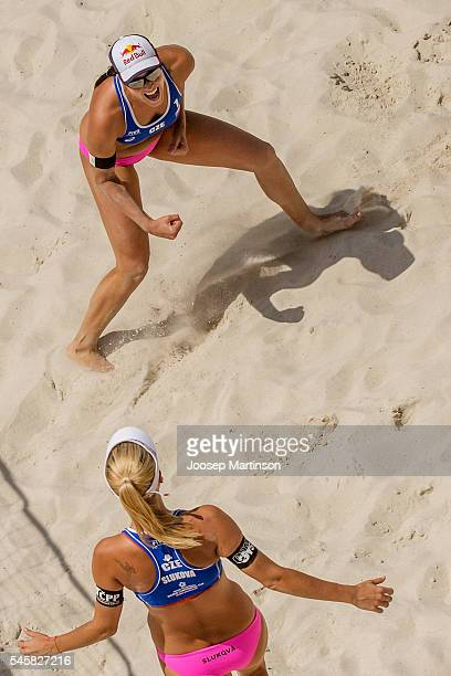 Marketa Slukova and Barbora Hermannova of Czech Republic celebrate winning the golden set against China and claiming ticket to Rio Olympics during...