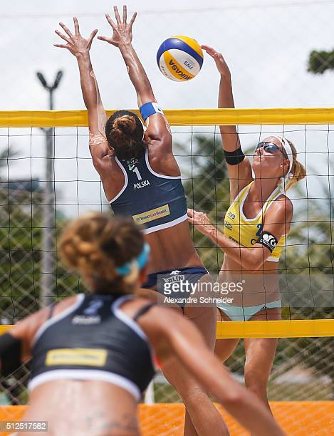 Marketa Slukova of Czech Republic spikes the ball against Poland during the main draw match at Pajucara beach during day four of the FIVB Beach...