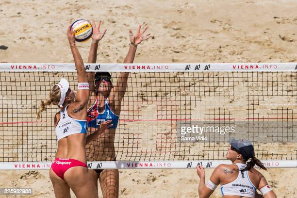Marketa Slukova of Czech Republic spikes the ball over Lauren Fendrick of the United States at FIVB Beach Volleyball World Championships on August 3...